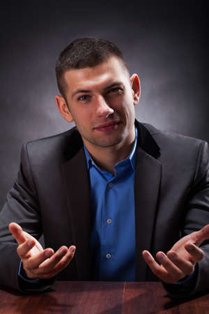 Intelligent looking crook explaining the advantages of contract Stock Photo - 25626859
