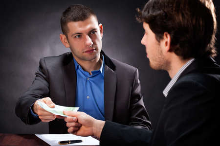 Fraud taking a money from man for a fake investment Stock Photo - 25626863