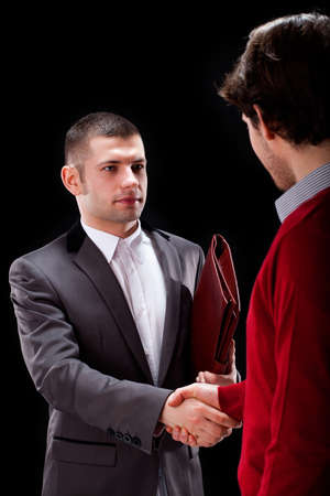 Elegant dishonest canvasser with briefacase talking with potential client Stock Photo - 25626864