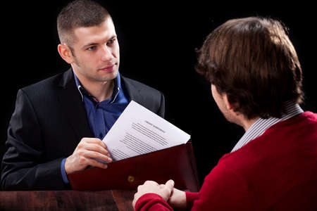 deceive: Dishonest insurance agent wanting to deceive his new client Stock Photo
