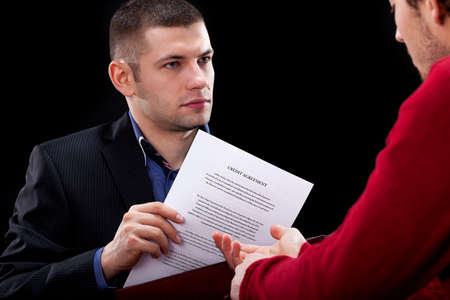 Dishonest usinessman hidding signed unfair contract Stock Photo - 25626866