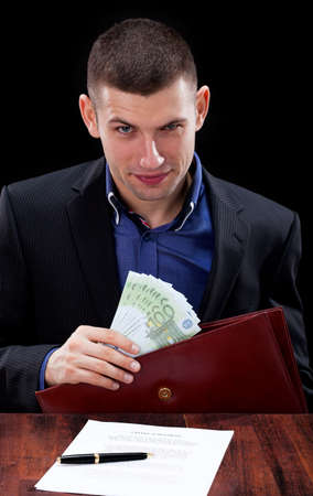 unfair: Dihonest businessman taking a bribe for signing unfair contract