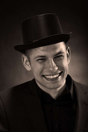 Smiled man wearing a bowler hat and a suit Stock Photo - 25626869