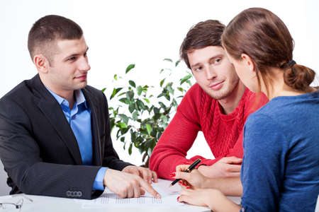 Couple signing the unfair mortgage agreement Stock Photo - 25626895