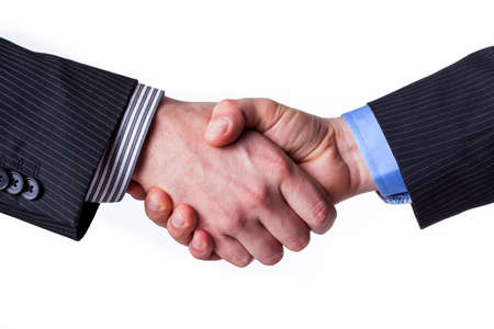 Busines handshake with a promise of partnership Stock Photo - 25626898