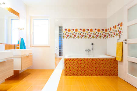 New contemporary bathroom with white and orange tiles  photo