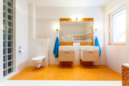warm home: Two big sinks and mirror at contemporary family bathroom