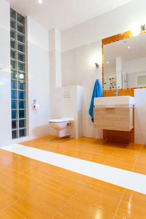 Big contemporary orange bathroom with toilet at new house Stock Photo - 25626911