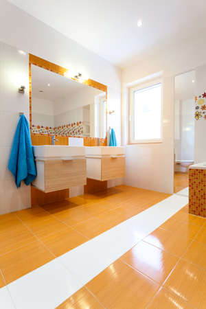 Big contemporary white and orange bathroom photo