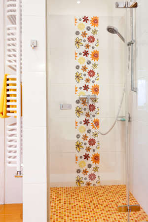 Colorful modern shower with flowers and transparent wall photo