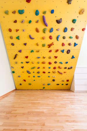 Yellow climbing wall in new kids room Stock Photo - 25626925