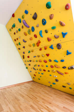 Small yellow climbing wall in children room in modern house Stock Photo - 25626926