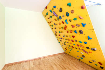 climbing wall: Oblique climbing wall at home as original way to sport Stock Photo