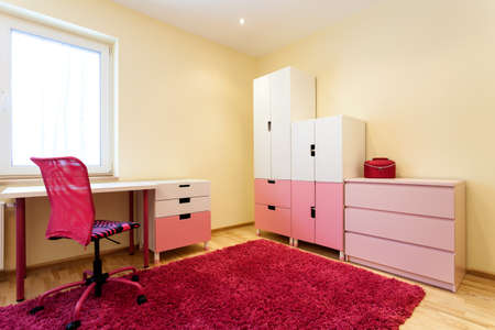 Cute little children room with pink soft carpet for girls Stock Photo - 25626930