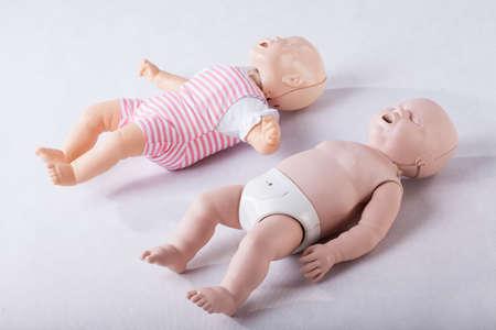 Two plastic baby phantoms for resuscitation practice