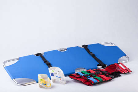 emergency stretcher: Stretcher, back protecting belts and bands