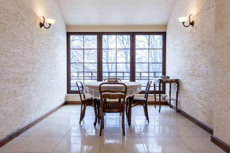 Beautiful elegant old-fashioned dining room in luxury stylish mansion photo