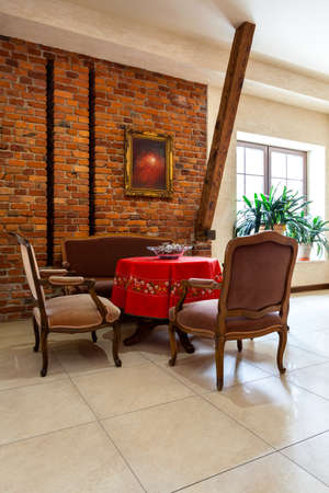 Elegance royal retro interior with stylish antique furniture and brick wall photo