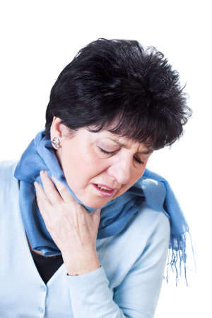 Sick woman with sore throat on white isolated background photo