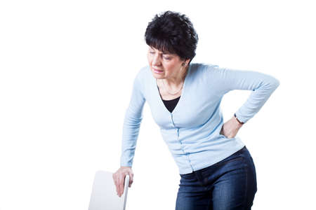 Woman having backache on white isolated background photo
