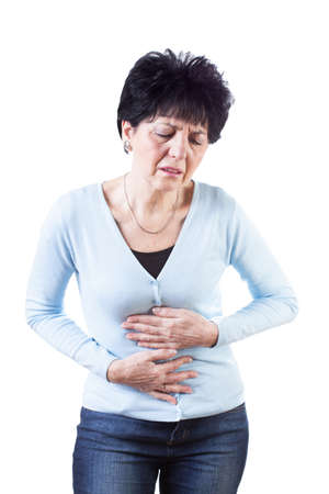 Woman in blue sweter having stomach ache photo