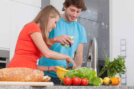 Couple preparing a healthy lunch with vegetables photo