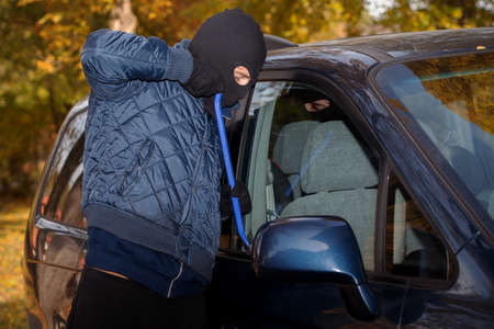 striving: A masked thief striving to steal a big car