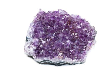 amethyst rough: Big shiny violet quartz amethyst on white background Stock Photo