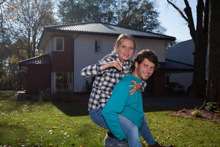 Couple happy because of the new house photo