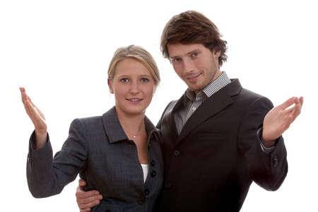 Businesswoman and man welcoming to their team in an inviting gesture Stock Photo