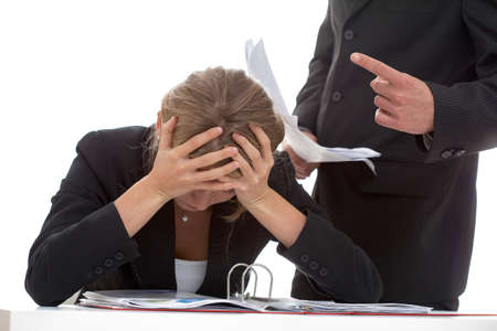 sad couple: An overtaxed employee feeling hemmed in by her strict boss