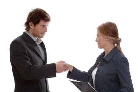 A man and a woman shaking hands introducing themselves photo