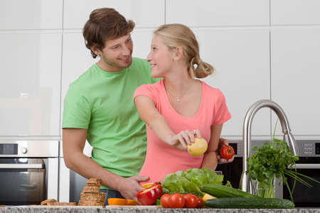 Couple making a healthy breakfast with vegetables photo