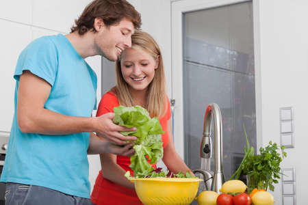 Couple doing diet lunch with different vegetables photo