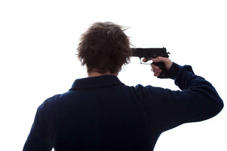 suicidal: A man having a suicidal attempt with a pistol Stock Photo