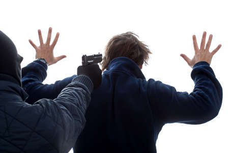surrender: A criminal threatening an innocent man with his hands up