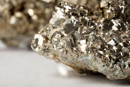 pyrite: Golden pyrite stone specimen with shiny reflections