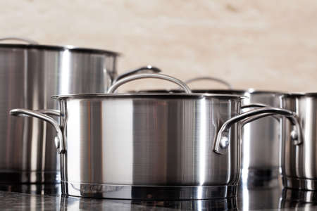 pot: New modern aluminum pots in closeup in the kitchen Stock Photo