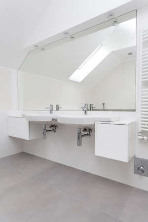 sinks: Countertop with two white sinks in modern batrhoom Stock Photo