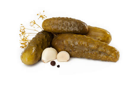 Four tasty pickles with garlic and peppercorn photo