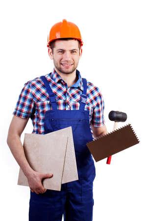 tiler: Tiler with work equipment on white background in blue overalls