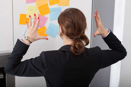 An iritated woman with to much appointments to handle Stock Photo