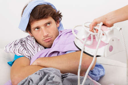 Lazy man dont wont help wife in ironing photo