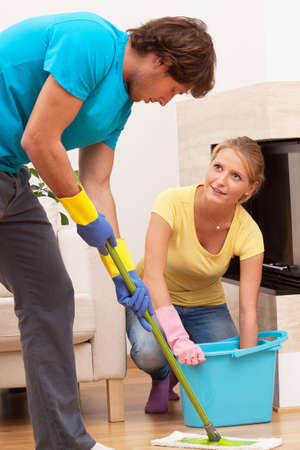 Good partner is helping wife to cleaning house photo
