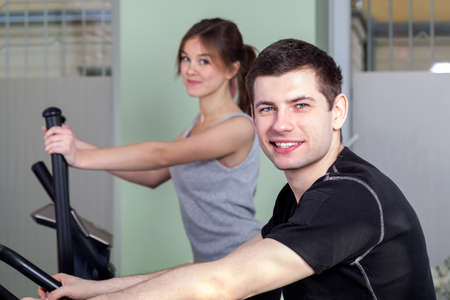 Young athletic people in modern fitness center  photo