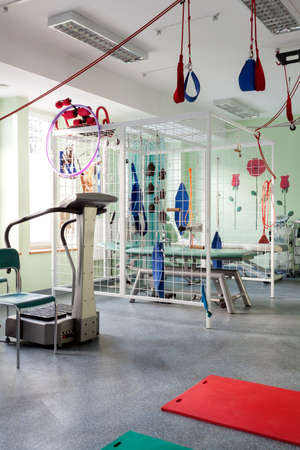 therapy room: Place with professional physiotherapy machines for exercises
