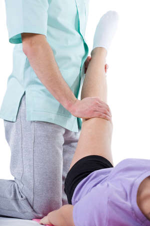 Professional leg stretching at physiotherapy cabinet photo