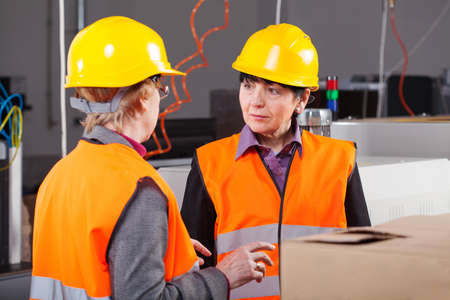 Middle aged women working as a managers at factory photo