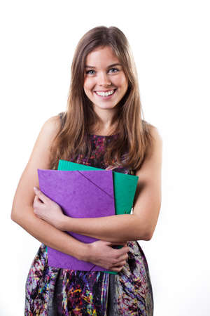Attractive student holding briefcase on white isolated background photo