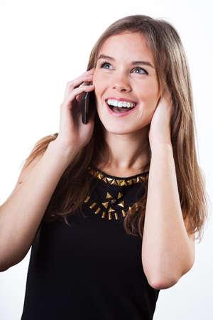 Happy stylish student talking on the phone  photo